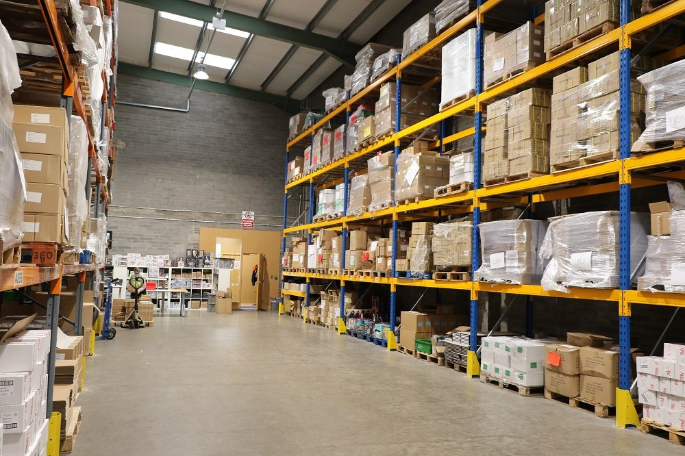 storage space and pallets occupied with products in the warehousee